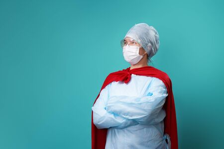 Photo for Doctor wearing surgical face mask in superhero cape. - Royalty Free Image