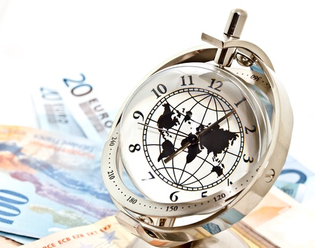 global model clock and Euro banknotes on white background