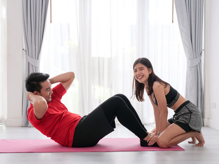 Foto per Happy Asian couple exercise at home together, lifestyle concept. - Immagine Royalty Free