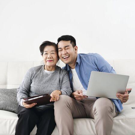 Foto de Asian agent man deal with senior for life insurance contract signed, business concept. - Imagen libre de derechos