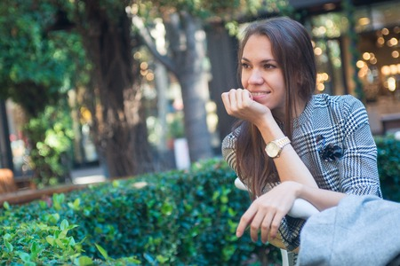 Photo for Smiling happy woman with wrist watch in the city - Royalty Free Image