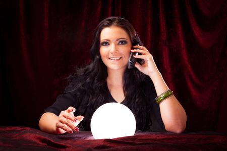 Foto de Friendly Fortune Teller With Crystal Ball - Imagen libre de derechos