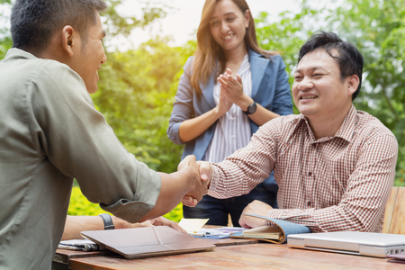Photo for Young business men are negotiating with customers. And shake hands after the negotiations. - Royalty Free Image