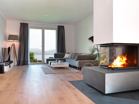 Foto de modern living room with fireplace and a view to the coast - Imagen libre de derechos