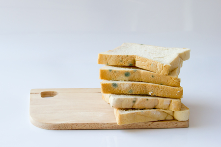 Foto de bread that has expired on wooden background - Imagen libre de derechos
