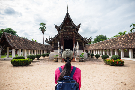 Photo for Back view of traveler wowan standing at Wat Ton Kwen (Wat Inthrawat), ancient temple in Chiang Mai,Thailand - Royalty Free Image