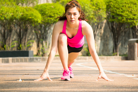 Photo for Asian sport woman ready on starting point for running / jogging - Royalty Free Image