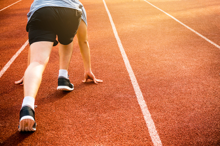 Foto per Athletic ready on starting point and ready for competition - Immagine Royalty Free