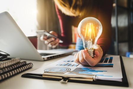 Photo pour business hand showing creative business strategy with light bulb as concept - image libre de droit