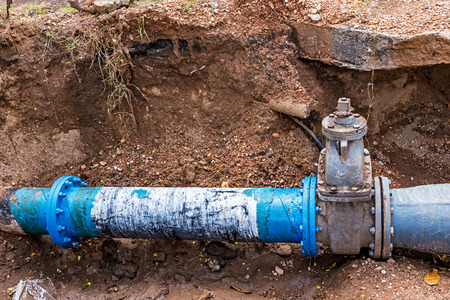 Photo pour Water PVC Plastic Pipes in Ground during Plumbing Construction site. - image libre de droit