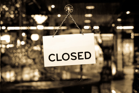 Photo for A closed sign hanging in a shop window - Royalty Free Image