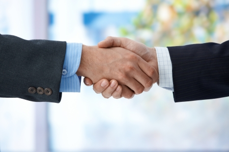 Businessmen shaking hand, closeup hands, business success, congratulation, agreement, deal.