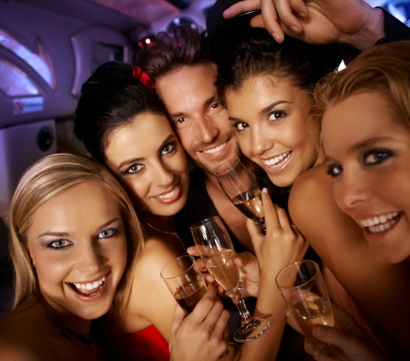 Young attractive people having party fun, drinking, laughing.