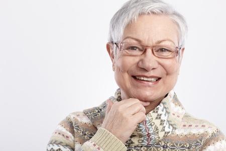 Foto per Closeup portrait of smiling elderly woman in glasses. - Immagine Royalty Free
