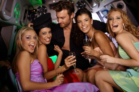 Photo for Sexy girls having fun in limousine with handsome man at bachelorette party. - Royalty Free Image