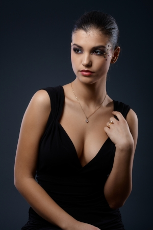 Photo for Elegant woman with fancy makeup in seductive black cocktail dress. - Royalty Free Image