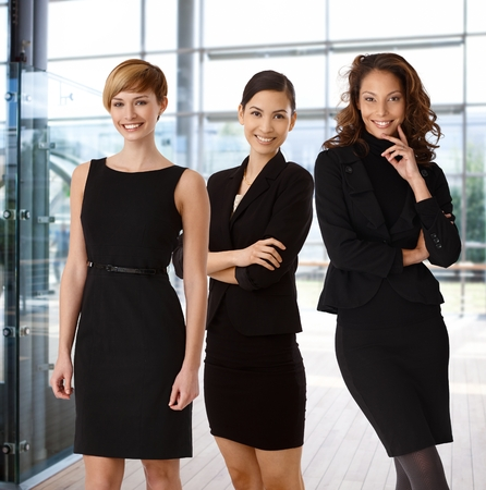 Foto de Interracial team of happy businesswomen at office lobby. - Imagen libre de derechos