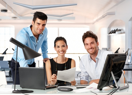 Photo pour Happy team of young business people working together in office. - image libre de droit