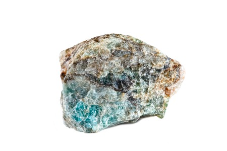 Foto de Macro shooting of natural gemstone. Raw mineral Apatite. Madagascar. Isolated object on a white background. - Imagen libre de derechos