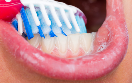 Close up photo of tooth brushing with toothpaste