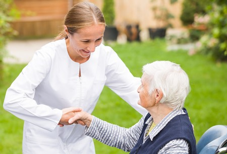 Photo pour Photo of young carer helping the elderly woman - image libre de droit