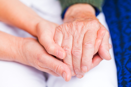 Photo pour Young carer giving helping hands for elderly woman - image libre de droit