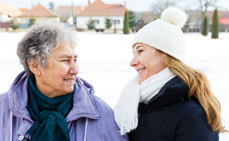 Foto de Photo of happy elderly woman and young caregiver - Imagen libre de derechos