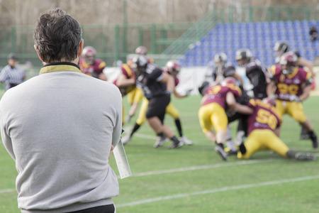Foto de Coach observing football match - Imagen libre de derechos