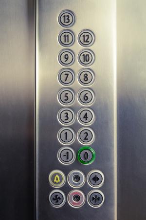 Photo pour Different buttons in modern metal elevator    - image libre de droit