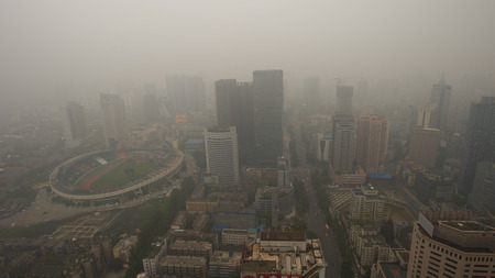 Photo for Bird view at chengdu China. Fog, overcast sky and pollution. - Royalty Free Image