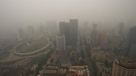 Photo pour Bird view at chengdu China. Fog, overcast sky and pollution. - image libre de droit