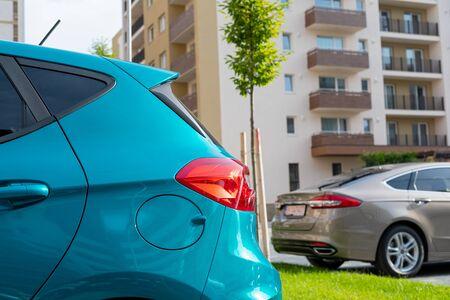 Foto de New apartment blocks with parking lot, parked cars outdoor - residential area - Imagen libre de derechos
