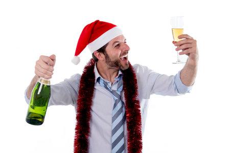 Happy businessman wearing a santa hat