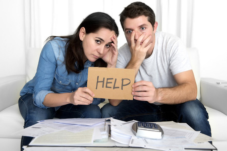 Photo for young couple worried need help in stress at home couch accounting debt bills bank papers expenses and payments feeling desperate in bad financial situation - Royalty Free Image