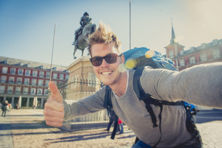 Photo pour young attractive student backpacker tourist taking selfie photo with mobile phone outdoors enjoying holidays travel destination in tourism and exploring concept - image libre de droit