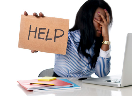 Photo pour black African American ethnicity tired and frustrated woman working as secretary in stress at work office desk with computer laptop asking for help in business frustration concept - image libre de droit