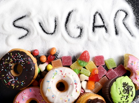 Photo for mix of sweet cakes, donuts and candy with sugar spread and written text in unhealthy nutrition, chocolate abuse and addiction concept, body and dental care - Royalty Free Image