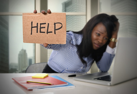 Photo pour black African American ethnicity tired and frustrated woman working as secretary in stress at work business district office desk with computer laptop asking for help in frustration concept - image libre de droit