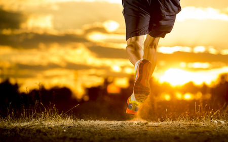 Photo pour close up image of young man strong legs off trail running at amazing summer sunset in sport and healthy lifestyle concept and jogging cross country training workout - image libre de droit
