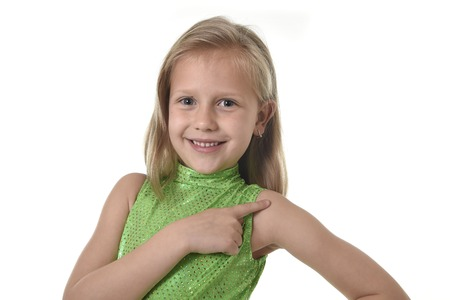 Foto de 6 or 7 years old little girl with blond hair and blue eyes smiling happy posing isolated on white background pointing shoulder in language lesson for child education and body parts school chart serie - Imagen libre de derechos