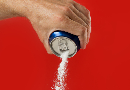 Foto de man hand holding refresh drink can pouring sugar stream in sweet and calories content of soda and energy drinks concept in unhealthy nutrition and diet concept - Imagen libre de derechos