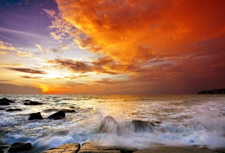 Foto de Tropical beach at sunset. Nature background  - Imagen libre de derechos