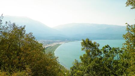 Photo pour View on coast of Lake Prespa and Mountains of Galicica National Park, Macedonia. Galicica is National park between two lakes - Ochrid and Prespa, known of it's wild nature. Balkan nature and exploration concept. - image libre de droit