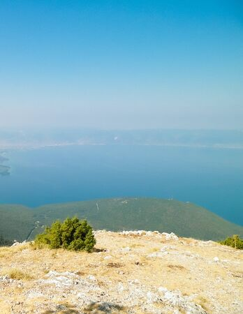 Photo pour Water of Lake Ochrid and Mountains of Galicica National Park, Macedonia. Galicica is National park between two lakes - Ochrid and Prespa, known of it's wild nature. Balkan nature and exploration concept. - image libre de droit