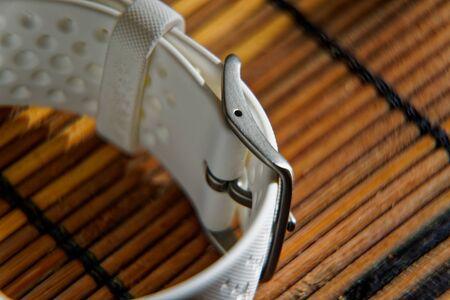 Foto de Sport watch in white color on wooden table, Smart watch for running and fitness training - Imagen libre de derechos