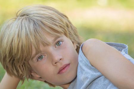Photo pour Portrait of a boy laying,resting his head on his hand - image libre de droit