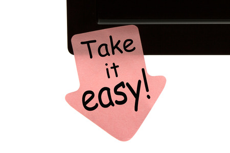 Photo pour Take It Easy written on reminder sticky note. Motivational concept. - image libre de droit
