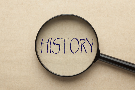 Photo pour Magnifying glass focusing on HISTORY word. Business concept - image libre de droit