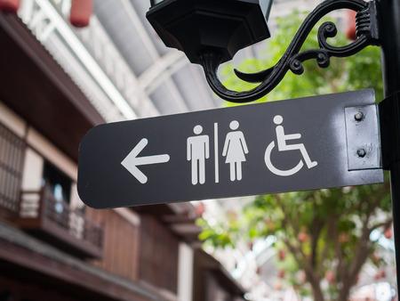 Foto de Public restroom signs with a disabled access symbol - Imagen libre de derechos