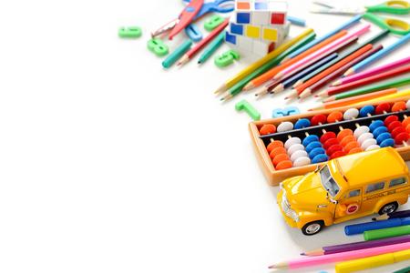 Foto de Colorful back to school supplies border over white table. Mental arithmetic. Space for text. - Imagen libre de derechos